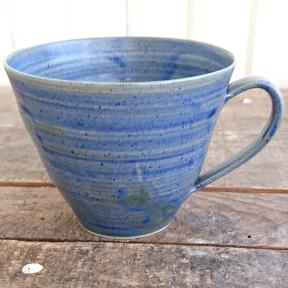 Blå kopp kaffe/te