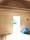 Isolering och panel i stuga..