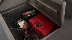 Skyddad förvaring för tank och batterier