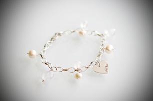 Armband med silverhjärta - En bricka