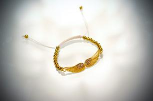 Änglavingar med guldiga pärlor