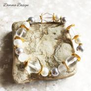 Elastiskt armband guld och vitt