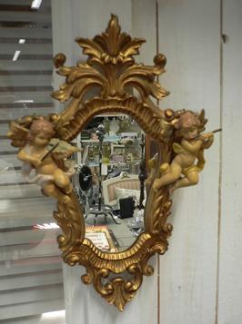 Liten spegel med änglar