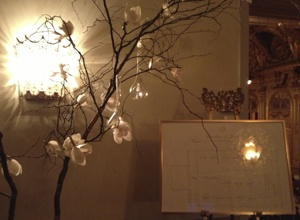 Hand made orchid tree with hanging lanterns made a romantic set up for the table plan area.