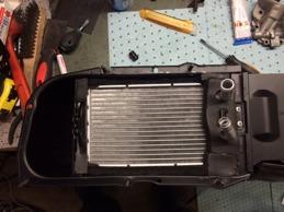 Nytt värmepaket på plats med nya packningar i blästrad och lackad värmebox.