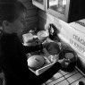 Ekaterina Zimina maiking porridge  in Vizhay. Dyatlov Pass