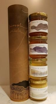 Fyra honungsorter i presentrör -