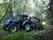 New Holland TD5 med skogsvagn