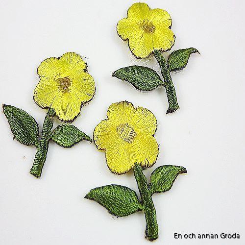 tygm gul blomma