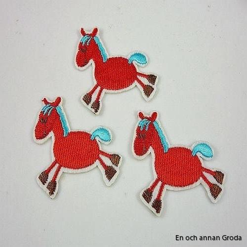 tygm röd häst
