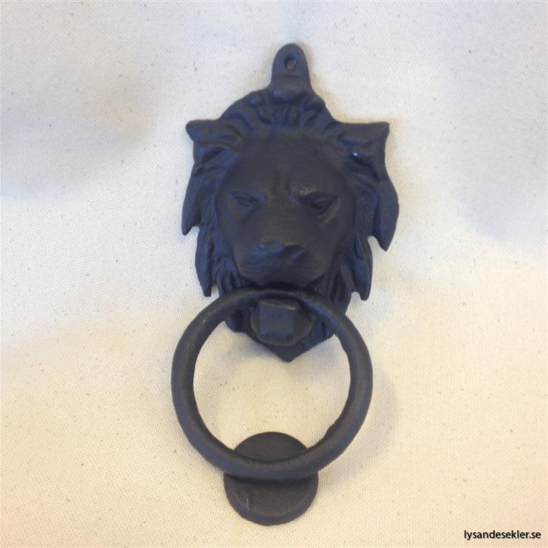 portkläpp lejon smide