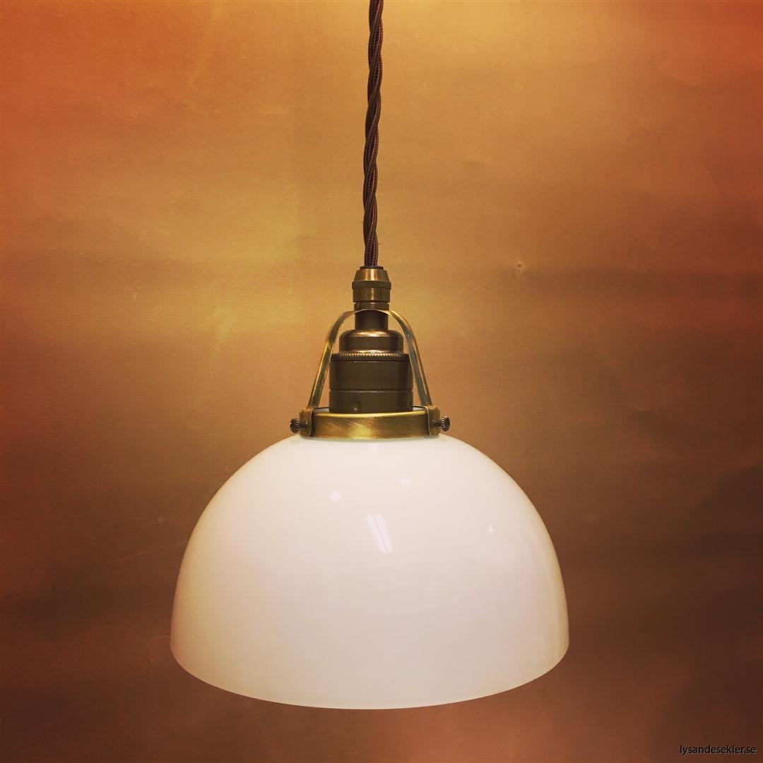 fönsterlampa tygsladd brun antik klofattning