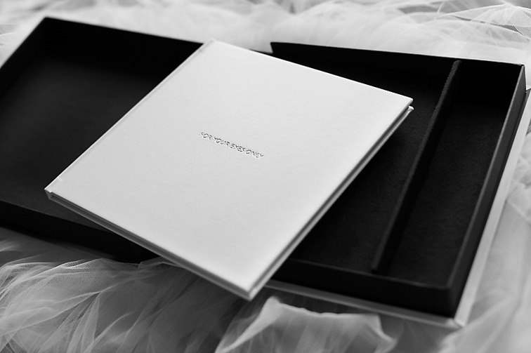 White leather on the book and black velvet inside the box!