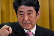 Japans premiärminister är inte riktigt redo att överge sin fordonsindustri, till kinesens fördel.