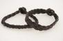 Plattflätat svart läderarmband