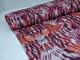 Mode stickad - Fjädrar rosa/lila