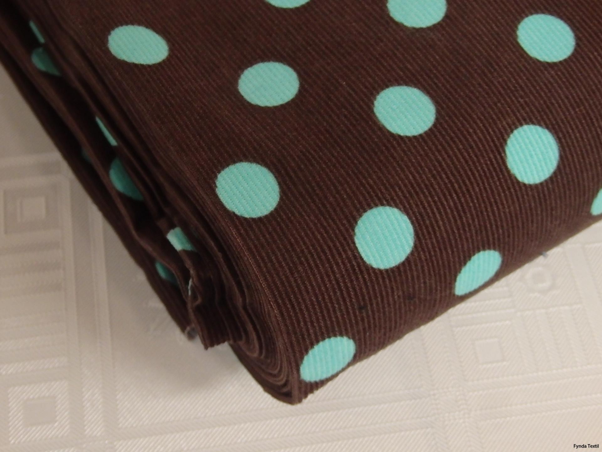 Mintgrön prick på chokladbrun botten