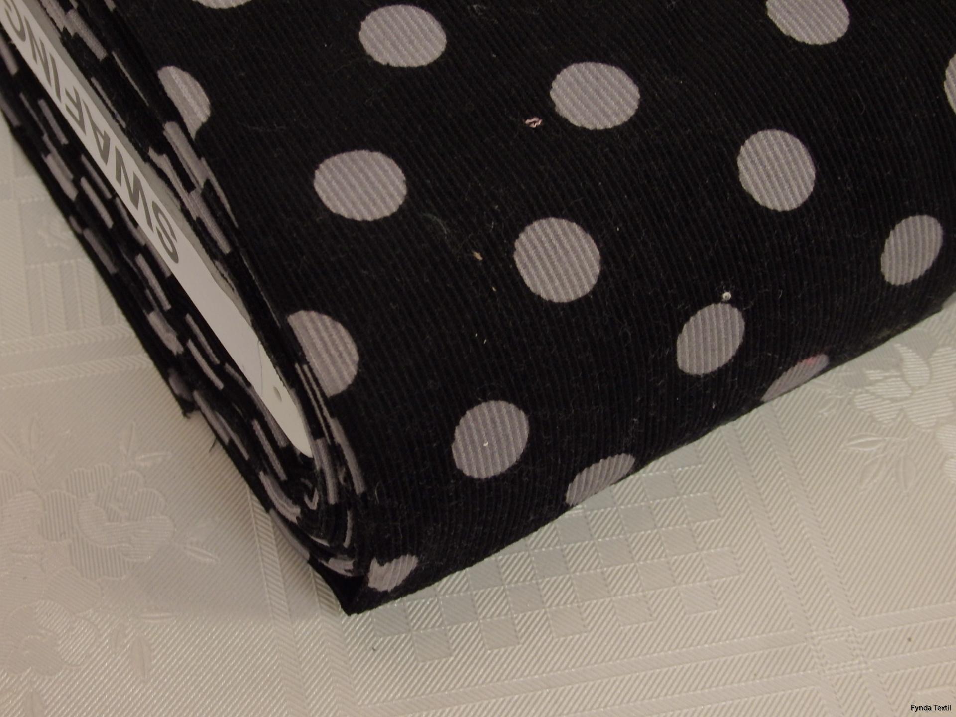 Mullvadsgrå prick på svart botten