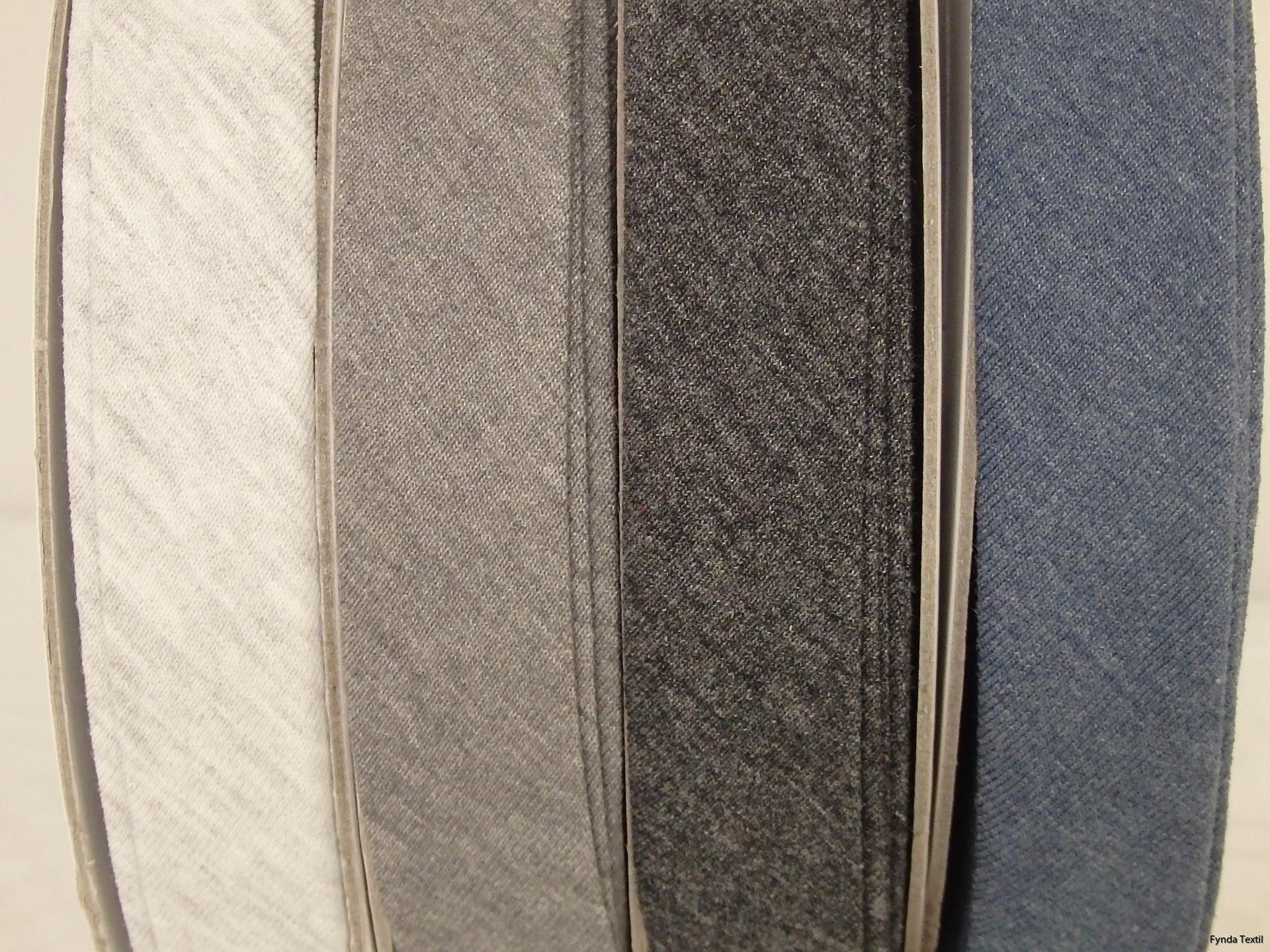 Från vänster: Ljusgrå, mellangrå, mörkgrå och jeansblå melerad