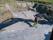Kistgravarna dräneras och vattnet leds bort i dränering under blivande väg