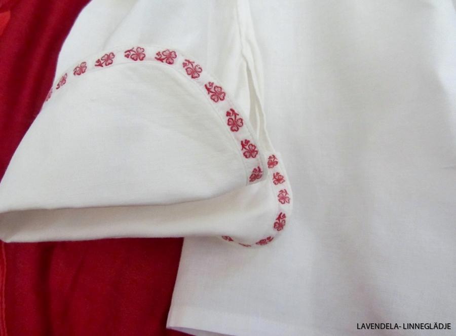 Manschett med bandet i rött och vitt