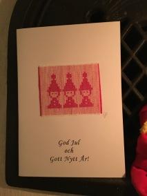 Ett fint julkort med tomtenissar. Handvävt. - Ett jättefint julkort med tomtenissar.