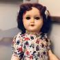 En mycket söt docka i massa. I en söt klänning från 50-talet!