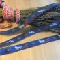 Ett äldre fint bomullsband 24 m. Oanvänt!