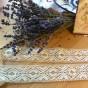 En fint handknypplad spets, 240 cm lång. Oanvänd! - En handknypplad spets