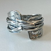 Minoo - En skönhet i oxiderat silver