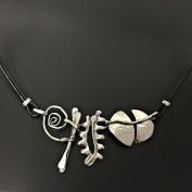 Malou - Mycket snygg design i silver och läder