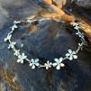 Silver flower halsband. Erbjudande med örhängen på köpet
