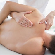7889849-physiotherapist-massaging-man