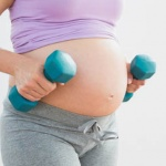 7823527-pregnant-woman-holding-dumbbells