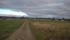 ...och en bondgård öster om banvallen.