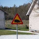 Varning för robotgräsklippare.