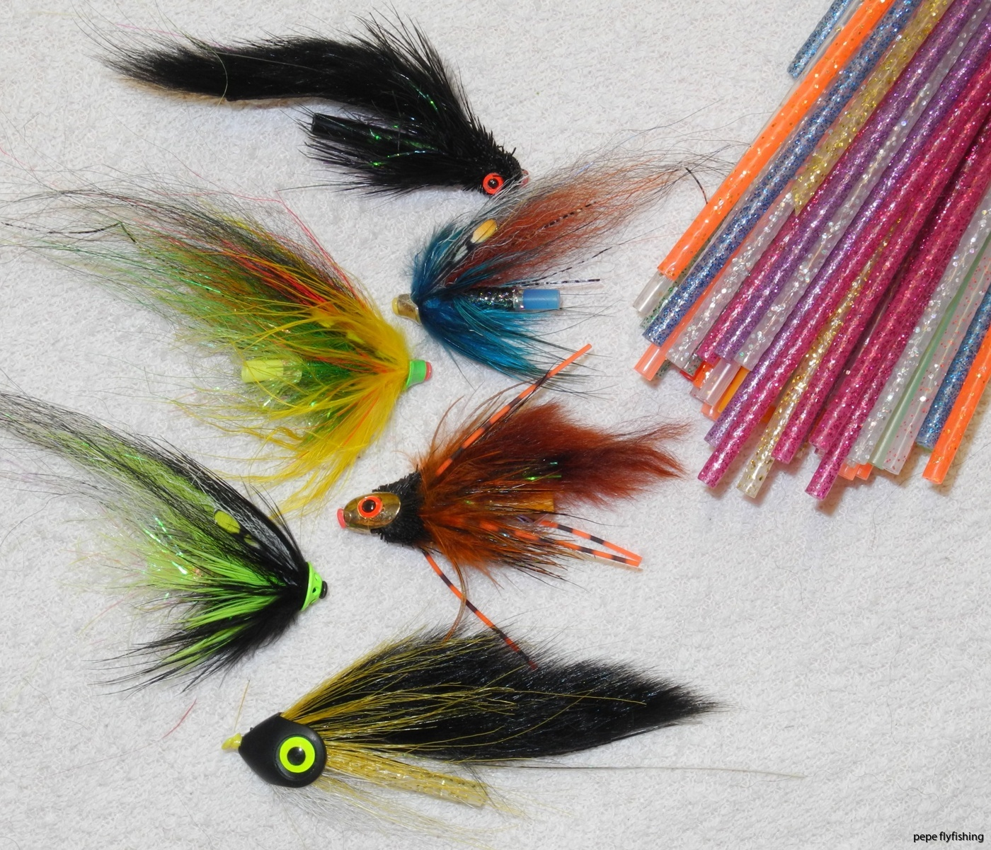 Plastic tube flies