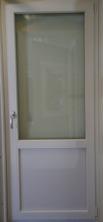 Inåtgående altandörr i PVC med bröstning