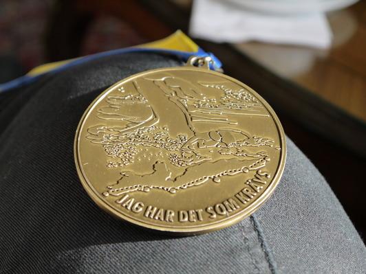 Men den medaljen får du inte förrän du är i mål. Skulle inte tro att jag får den...