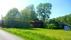 Sörgården på höjd ovan kyrka och park