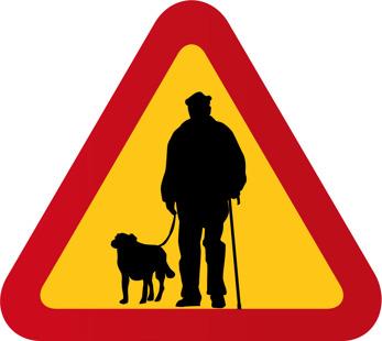 Gubbe med käpp och hund