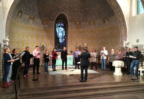The Eric Ericson Chamber Choir and conductor Fredrik Malmberg during dress rehearsal.