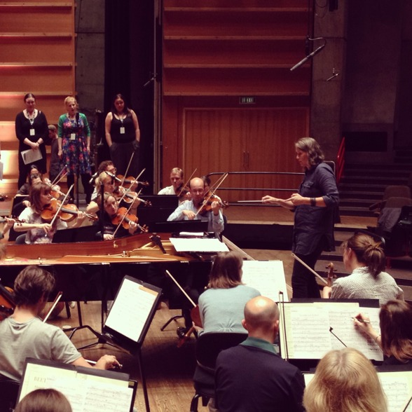 """Grete Pedersen during rehearsal, conducting """"Friede auf Erden"""" in Grieghallen, Bergen."""