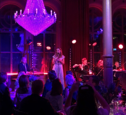 Hannah Holgersson singing during event in Stockholm.