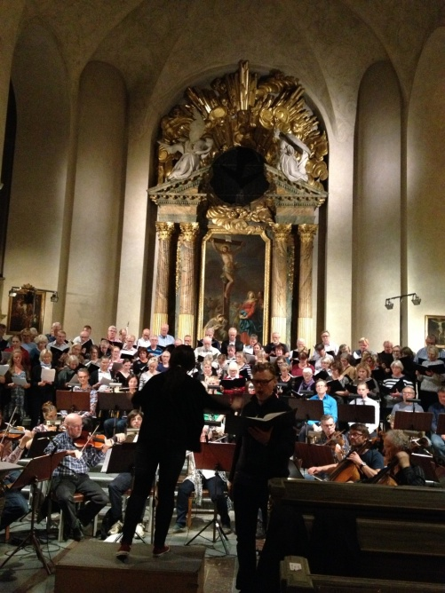 During rehearsal. Karl-Magnus Fredriksson singing and Marie Rosenmir conducting.