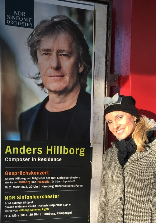 Hannah Holgersson and a poster of the Hillborg concerts in Hamburg.