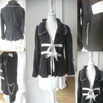 Vanja 101 - Vanja 101 svart linne med vitadetaljer