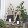 Julgran med ljushållare