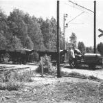 Torvtåg som korsar den stora järnvägen Kittlakull.