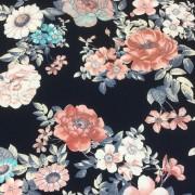 Blommor på mörkblå botten trikåtyg